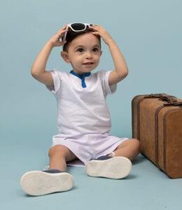 baby boy with white shirt holding eye glass