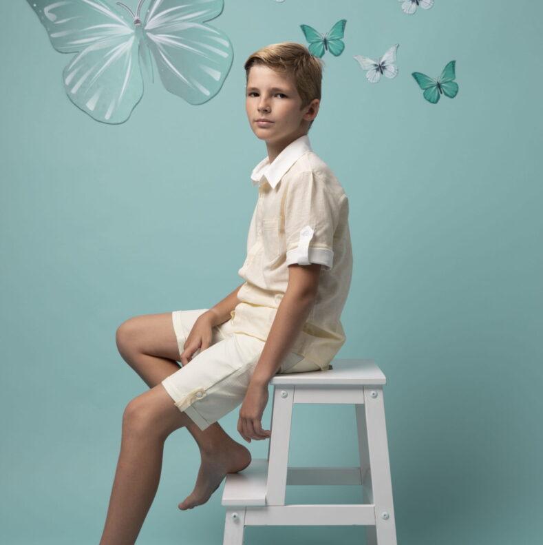 Boy seating on a chair - julesandjuliette